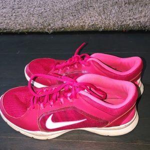 super cute hot pink NIKE running shoes